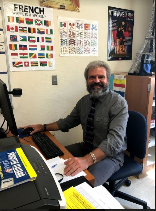 Italian+Teacher%2C+Mr.+Volpe%2C+sitting+in+his+classroom.+Picture+by+Catarina+Ferrao
