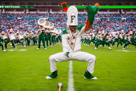 MIAMI GARDENS, FL - SEPTEMBER 05: A drum Major of the Marching 100 performs during their dance routine at the Orange Blossom Classic game between the Florida A&M Rattlers and the Jackson State Tigers on Sunday September 5th, 2021 at Hard Rock Stadium in Miami Gardens, FL.  (Photo by Nick Tre. Smith/Icon Sportswire via Getty Images)